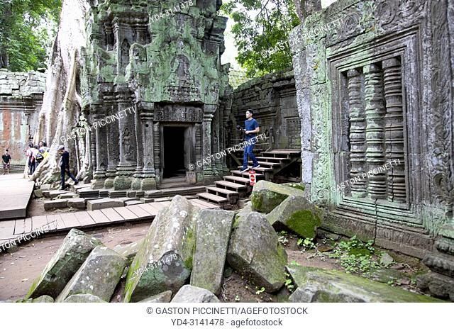 Tourists in Ta Prohm temple in Angkor Wat, Siem Reap, Cambodia. Ta Prohm is the modern name of the temple at Angkor, Siem Reap Province, Cambodia