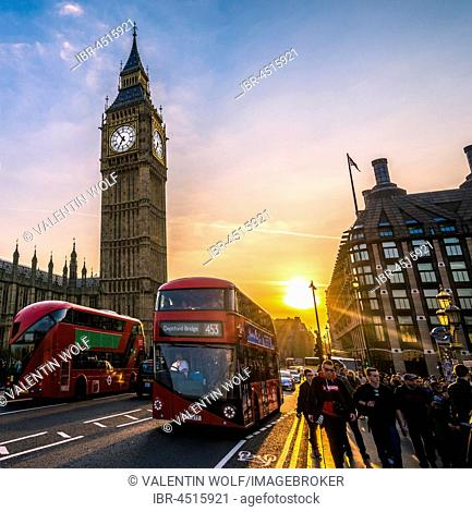 Red double decker bus in front of Big Ben, Houses of Parliament, backlit, Sunset, City of Westminster, London, London region, England, United Kingdom