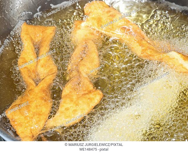 Angel wings are a traditional sweet crisp pastry made out of dough that has been shaped into thin twisted ribbons, deep-fried and sprinkled with powdered sugar
