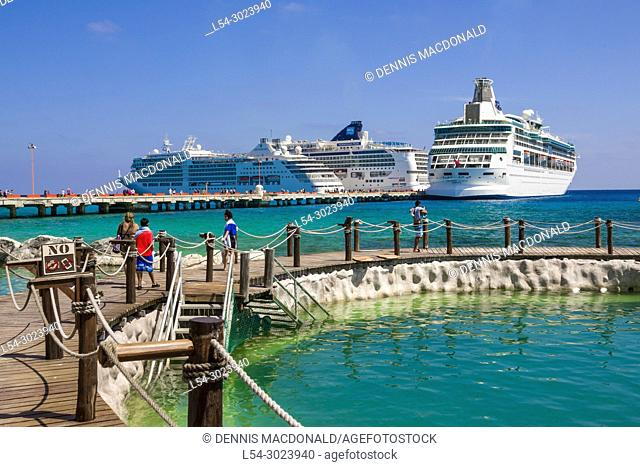 Docked cruise ships atThe Cruise destination Costa Maya Mexico America is a popular stop on the Western Caribbean cruise ship tour and affords shopping and...