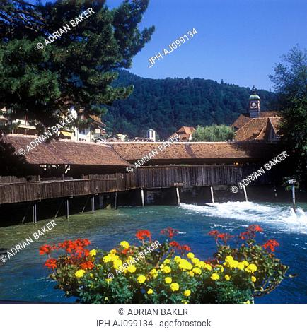 Ancient covered bridge crossing the River Aare at Thun