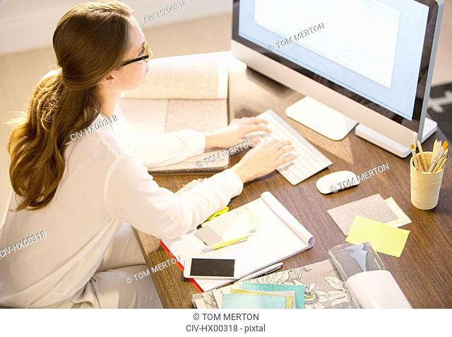 Interior designer working at computer in home office