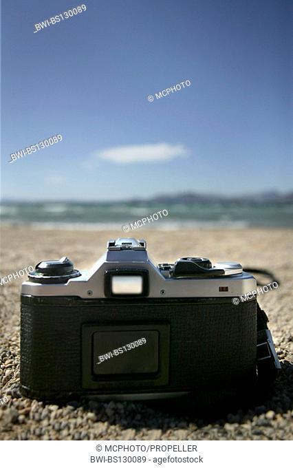 camera lying on the beach