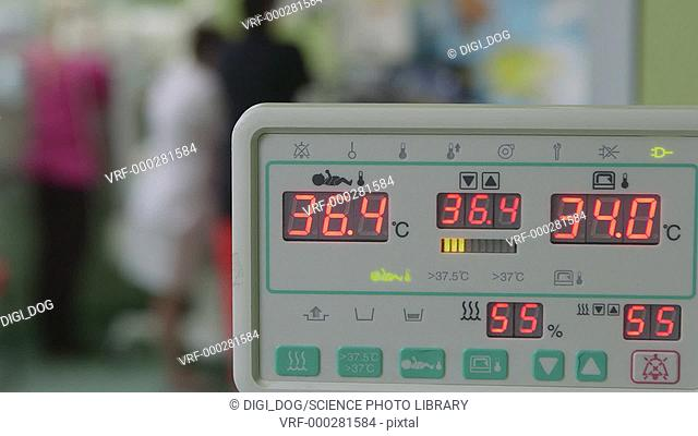 Medical monitoring device used in a hospital intensive care unit (ICU) to show a newborn's vital signs