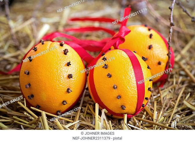 Oranges decorated with ribbons and cloves