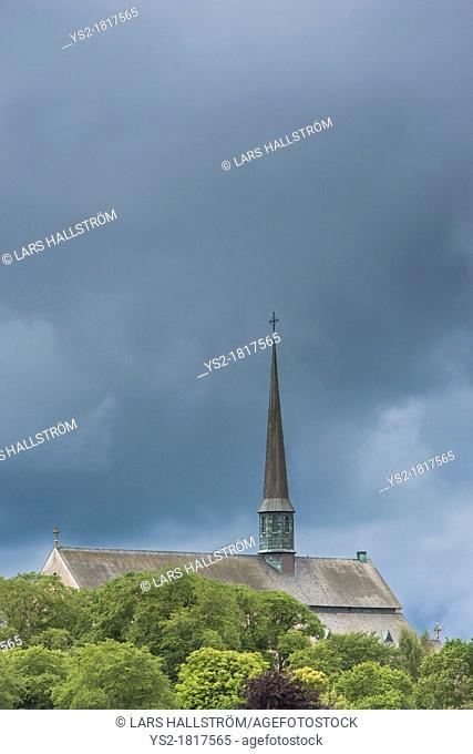 Old church and dark rain clouds