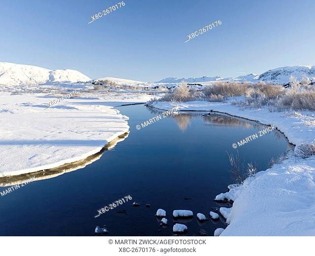 The river Oexara in in the Thingvellir National Park in Iceland during winter. Thingvellir is listed as UNESCO world heritage site
