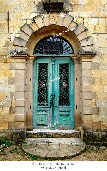 Mosque doorway with star and crescent moon symbols in hillside village of Yesilurt Malatya Turkey
