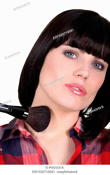 Woman using a blusher brush