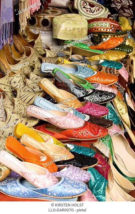 Brightly Coloured Shoes at a Market Stall  Dubai, United Arab Emirates