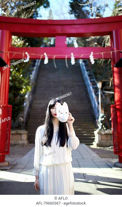 Young Japanese woman with fox mask