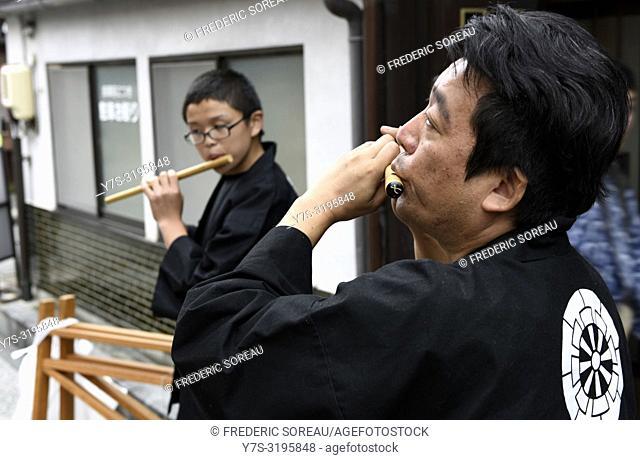 Musician for the Takayama festival, Takayama, Japan, Asia