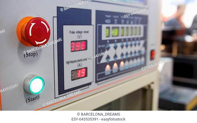 Remote control for machine at industrial manufacture factory, close up
