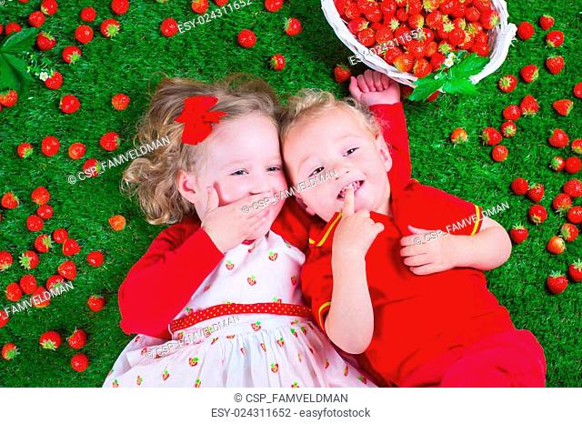 Children eating strawberry