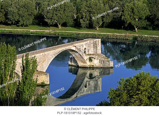 Reflection of the Pont Saint-Bénézet / Pont d'Avignon in water of the Rhône river, Avignon, Vaucluse, Provence-Alpes-Côte d'Azur, France