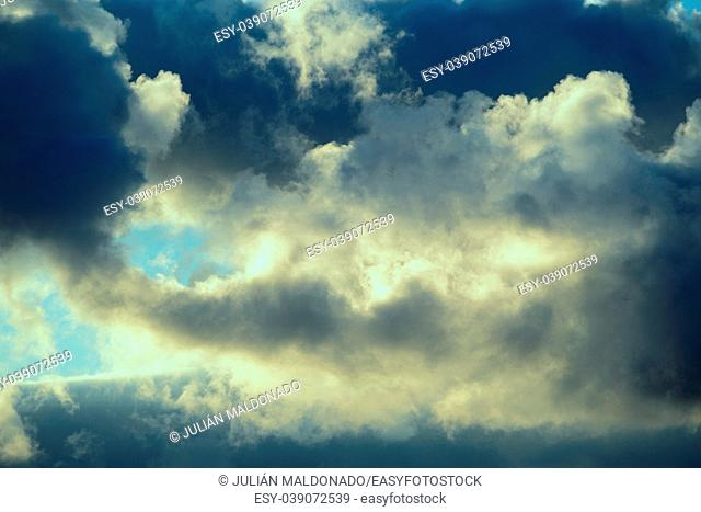 Clouds illuminated by the Sun in backlight
