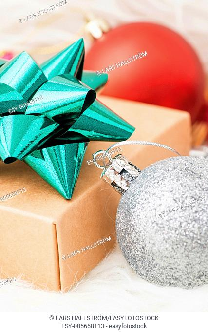 Holiday ornaments with christmas theme. Bauble, decoration and christmas gift