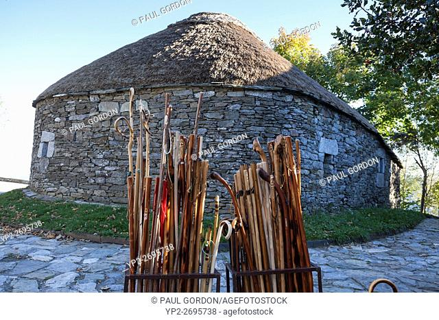 O Cebreiro, Spain: Walking sticks for sale in front of a traditional palloza typical to the Serra dos Ancares region of Galicia