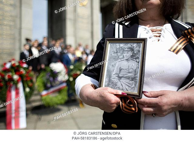Adelaida holds a photo of her father Nikolai, who died in the Second World War, on the 70th anniversary of the end of the war at the Soviet Memorial on Strasse...