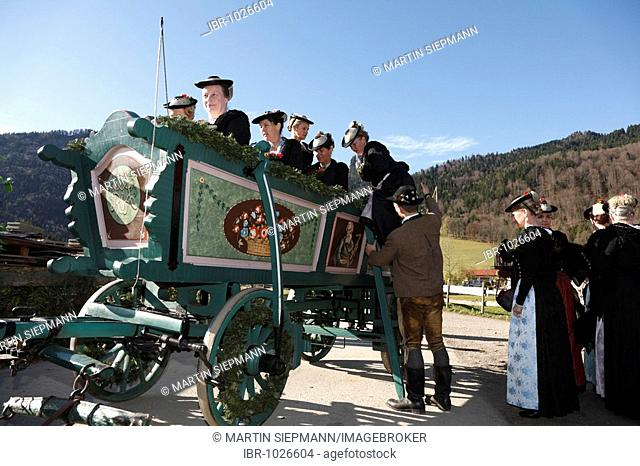 Women wearing tradiotional costumes on a coach, Leonhardifahrt, the feast day of Saint Leonard of Noblac, Kreuth, Tegernsee Valley, Upper Bavaria, Germany