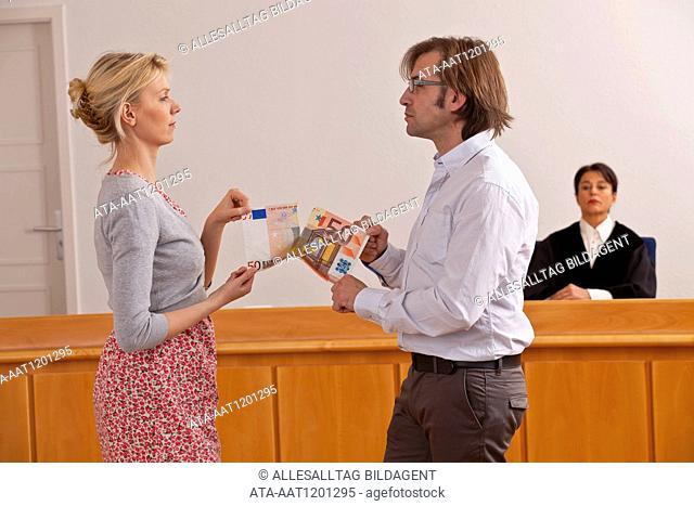 Couple quarreling for money in the courtroom