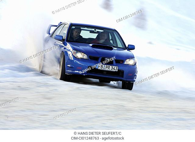 Subaru Impreza 2.5 WRX STi, model year 2005-, blue moving, diagonal from the front, frontal view, Snow, Winter