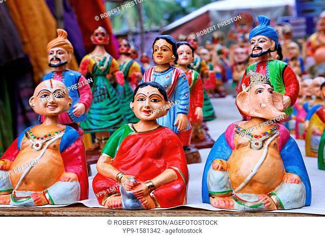 Market stall selling papier mache figures, Anjuna Market, Goa, India