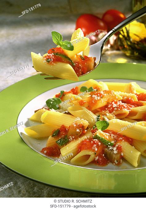 Penne with tomato sauce and fresh basil