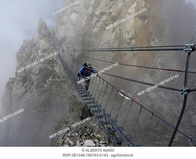 rope bridge misty weather along the via ferrata Sentiero dei Fiori route with fixed ropes, Austria/Italy battlefront during WW I, Lagoscuro mountain chain