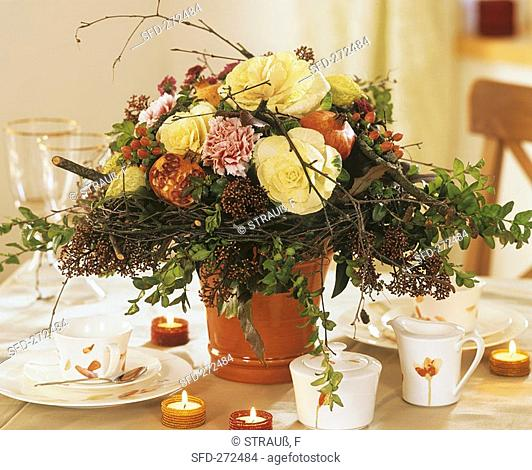 Arrangement of ornamental cabbage, pomegranates & birch wreath