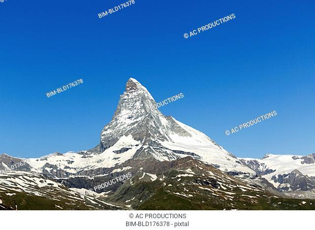 Matterhorn mountain in remote landscape, Canton Wallis, Switzerland