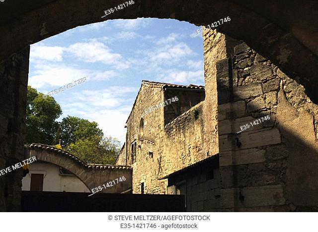 A Renaissance era arch and courtyard in one of the oldest sections of Pezenas, France