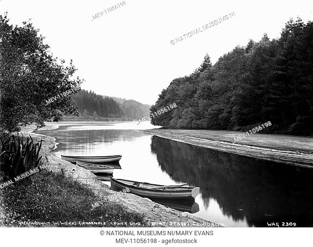 Rathfarnham W. Works Glenasmole Lower Lake, (Boat Stage), Co. Dublin - a view of a lake with boats in the foreground tied to the side
