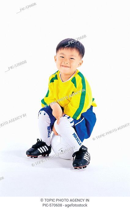 Korean Boy in Soccer Uniform