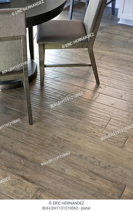 Close-up of wooden floor with cropped chair at home