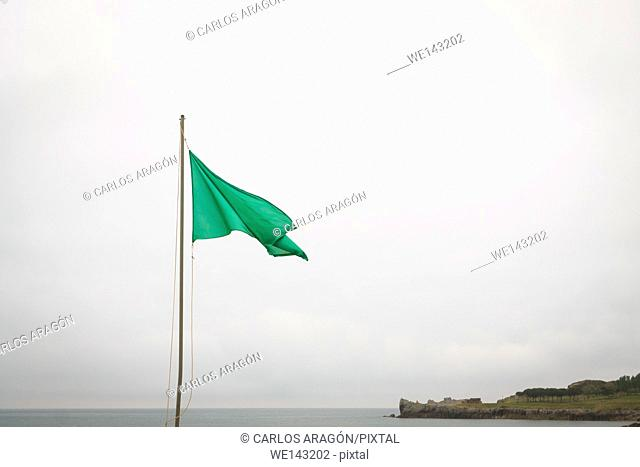 Green flag in the Castro Urdiales beach, Spain