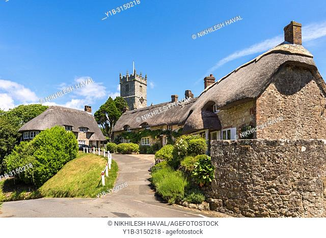 All Saints Church tower and thatched cottages, Godshill, Isle of Wight, UK