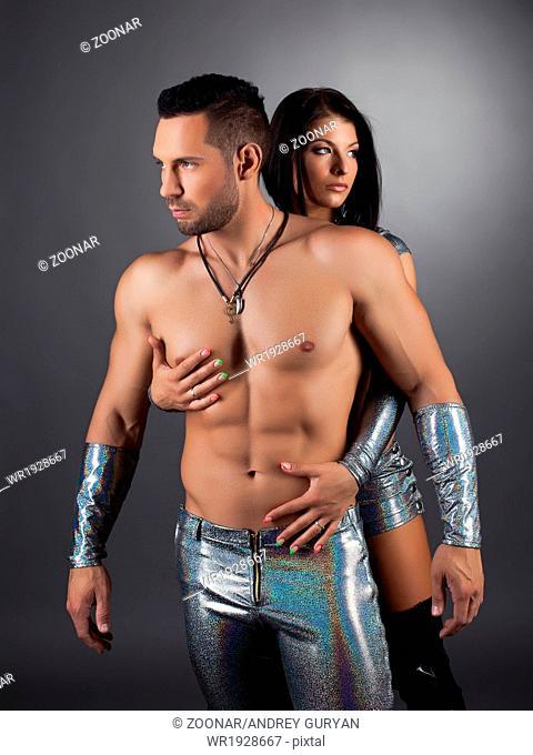 Duo of striptease performers posing in studio
