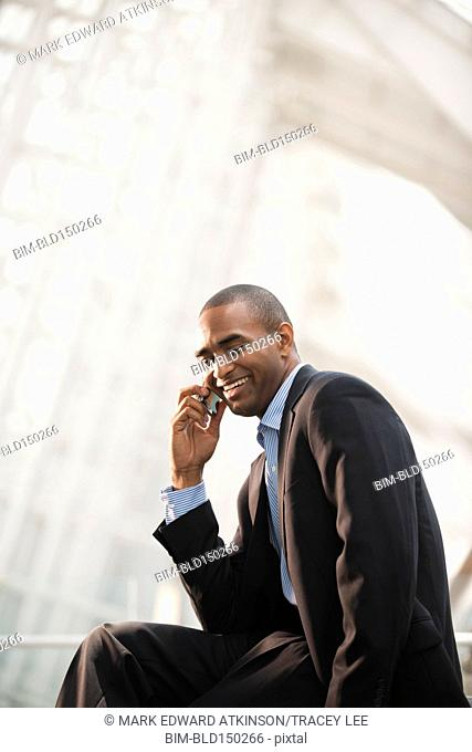 Black businessman talking on cell phone