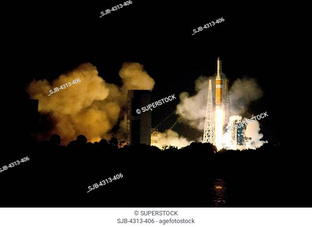 A Delta IV-Heavy rocket roars off Pad 37B at Cape Canaveral with a torrent of fire. Onboard is the NRO L-32 spy satellite