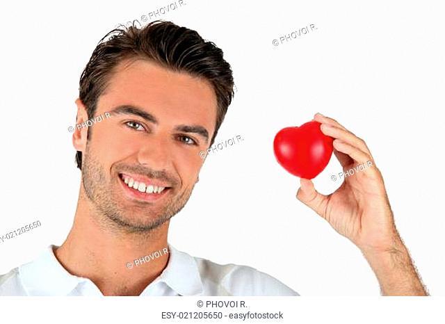 man holding a little heart