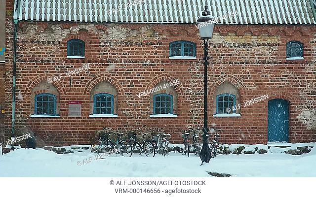 Snowfall at old house