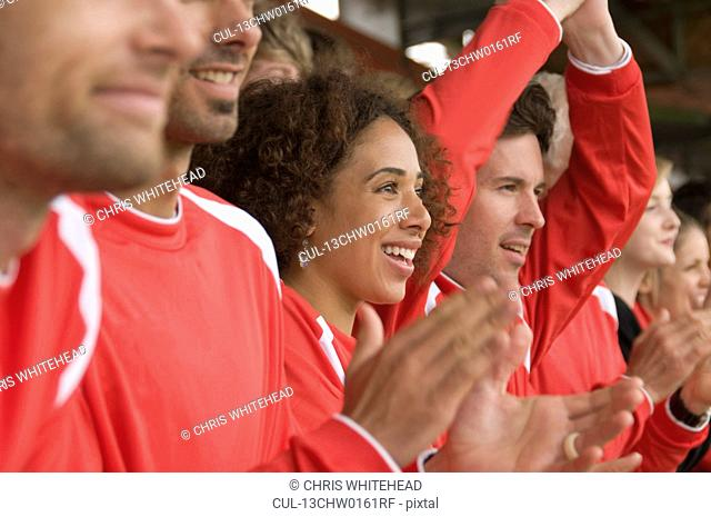 Fans clapping at football match