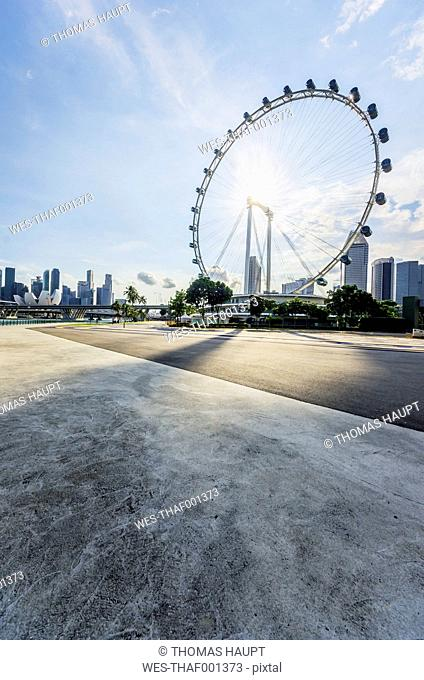 Republic of Singapore, Singapore, Marina Bay District, Singapore Flyer against the sun
