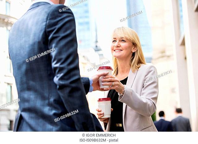 Businesswoman and businessman on coffee break