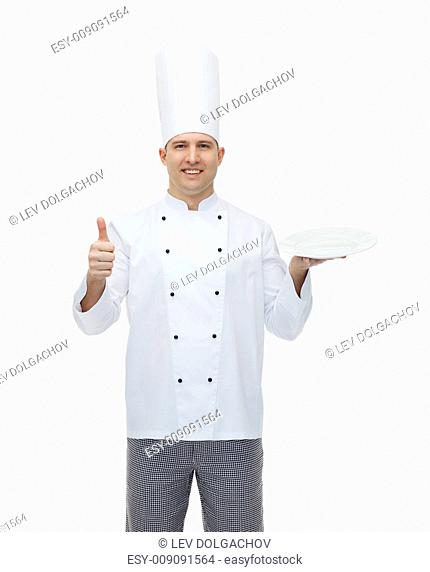 cooking, profession, advertisement and people concept - happy male chef cook holding something on empty plate and showing thumbs up