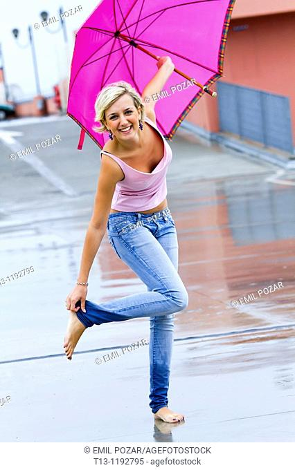 Young woman, wet legs and raining season