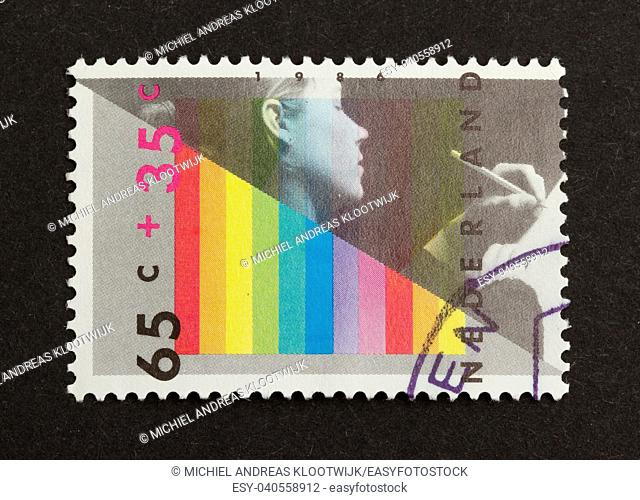 HOLLAND - CIRCA 1980: Stamp printed in the Netherlands shows a person and several colors, circa 1980