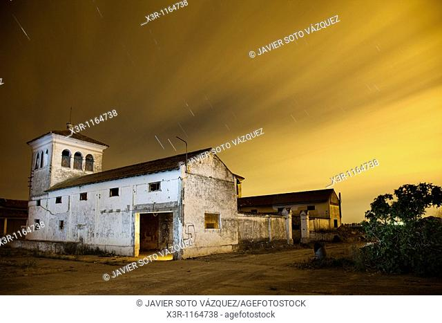Farm house at night with starry skies and