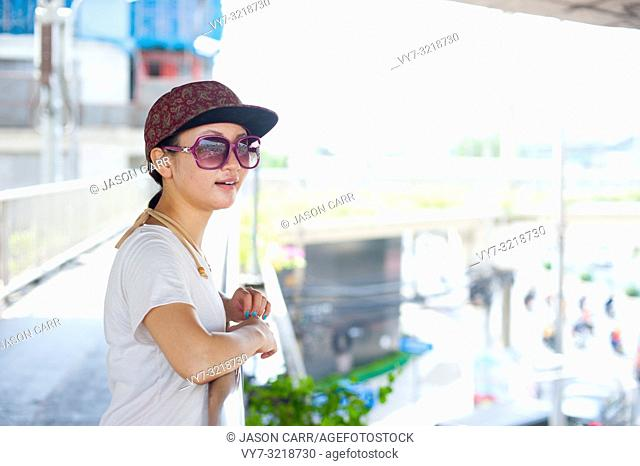 Japanese girl poses for pictures in Bangkok, Thailand